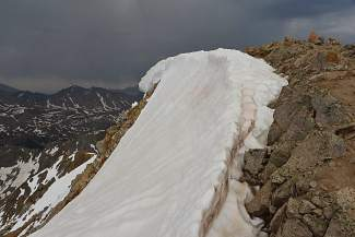 A rooster tail on the north face below the summit of Huron Peak (14,003 feet) in early summer.