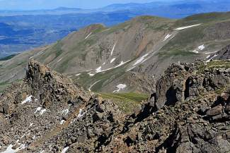 Gaining the upper ridge of Mount Harvard requires grabbing handholds and scrambling up a steep chute on the north face of the mountain.