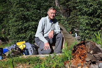 The author at base camp for Mount Harvard. Camp for an early-morning approach was among the spruce trees beside Frenchman Creek, five miles from the trailhead at 11,550 feet.