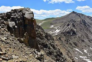 Mount Columbia (14,073 feet) is an easy walk-up across a long boulder field compared to the path-finding scramble on the rugged ridge of Mount Harvard (14,420 feet).
