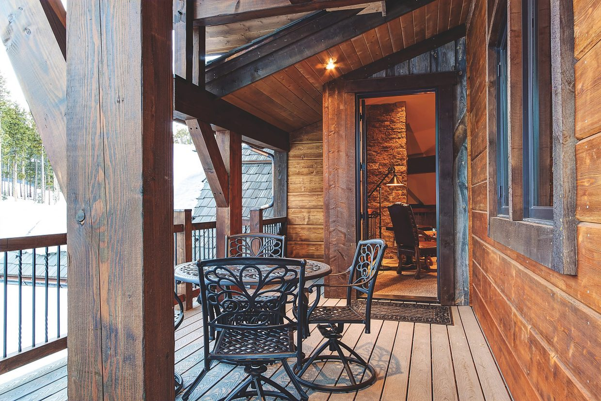 An outdoor deck right off the master bedroom offers privacy without cooping you up.