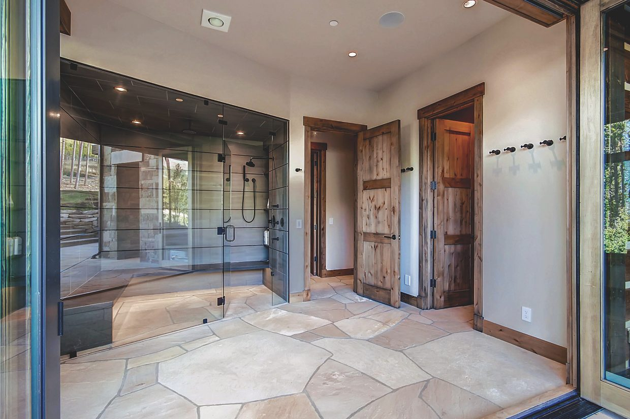 This shower area opens right out onto the patio and hot tub.