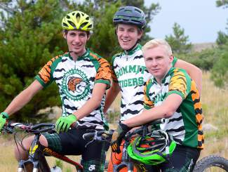 Senior Connor Hintgen (right) with fellow Summit mountain bike team riders Logan Ramsay (left) and Cooper Orr before practice at the Frisco Peninsula earlier this season.