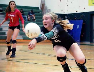Summit High's Lexi Zangari (4) goes for a dig as Sage Kent (1) looks on during the Tigers match against Eagle Valley on Sept. 17. Senior co-captain Zangari recently committed to playing Division II volleyball for Lees–McRae College, a Division II athletics school in North Carolina.