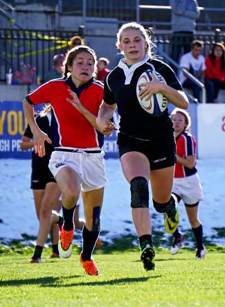 Summit's Becca Jane Rosko, right, carries the ball in for a try during the Tiger's 64-7 win over Chaparral to claim their eighth straight Colorado state rugby championship at Infinity Park in Denver last fall. After leading her team to a championship all four high school seasons, Rosko was accepted to the Dartmouth College women's team — along with fellow powerhouse Penn State.