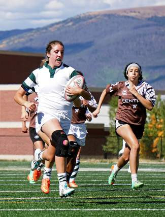 Summit High's Meg Rose, left, sprints away from the Palmer defense to score a try during the first half of the Tiger's 49-0 win last fall. Next year Rose will play Division I college rugby.