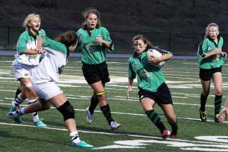 Ally Pothier breaks for a run during Summit High's annual intersquad Green vs. White scrimmage in 2014. Pothier recently committed to playing Division I rugby for American International College in Massachusetts next year after a strong senior season on the pitch.