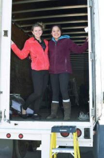 Summit High School seniors Tucker Hackett and Reena John are part of the 10-member team from the Spanish Honor Society traveling to volunteer in Honduras next month. One of the ways they raised money for the trip was by accepting donations to fill a large truck over the weekend.