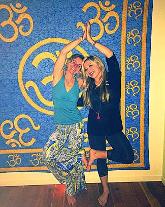 Friend Leslie Ross and Lauren Hoover strike a yoga pose together. Lauren Hoover's friend remembered she would get up early every morning to go for a run, do yoga, snowboard and make the most of each day. Vertical Runner is hosting the first-annual Love and Light Moonlight 10K from Breckenridge to Summit High School in Hoover's honor on June 18.