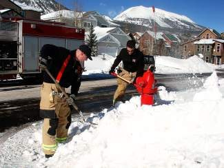 Lake Dillon firefighters Doug Beeler, left, and Lou Laurina dig out a fire hydrant in Frisco this week. Summit County's firefighters appreciate any help in clearing snow from hydrants to ensure easy and quick access in case of a fire.