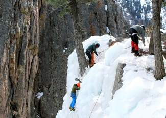 Climbers prepare to anchor at the top of a canyon above the Ouray Ice Park, found in riverbed surrounded on all sides by ice faces. The park has turned sleepy Ouray into a Mecca for ice climbers, earning it the nickname The Switzerland of America.