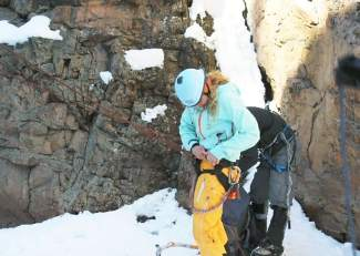 The author preps her equipment before trying her hand at ice climbing at the Ouray Ice Park. Ice climbing combines the technical prowess of rock climbing with the unpredictability of a slick (and sometimes moving) surface in the heart of winter.