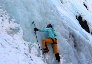 The author makes her first few moves on an ice wall at the Ouray Ice Park. The park is home to more than a dozen faces and hundreds of routes from January to the end of the season in mid to late-March.
