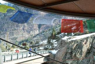 Flags wave in the wind at a traditional temple outside of the Ouray Ice Park, found in southern Colorado roughly two hours from Grand Junction deep inside of Uncompahgre Gorge.