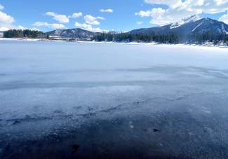 The north shore of Lake Dillon in late April, when ice closest to shore is already melted and ice just feet away from the shore is beginning to fracture. Local experts suggest staying off the ice anytime this spring, even if it looks or feels safe.