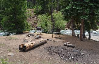 Chairs and an abandoned campfire at a site along Montezuma Road and adjacent to the Snake River sit deserted after the Forest Service recently issued an emergency closure of the area to all overnight camping due to heightened bear activity.