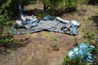 Trash, such as this broken tent, is prevalent at previous campsites along Montezuma Road in Keystone following notable long-term and illegal residential stay overs.