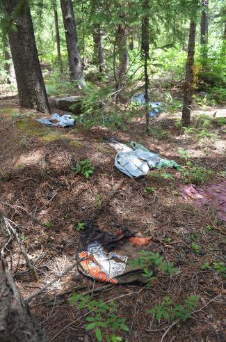 Trash, such as these soiled clothes, is prevalent at previous campsites along Montezuma Road in Keystone following notable long-term and illegal residential stay overs.