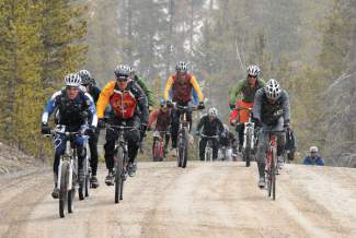 Cyclist climb along the base of Peak 7 on the way to Peak 8 while competing in the Imperial Challenge. After riding from the Breckenridge Recreation Center to the the base of Peak 8, racers transition into skis before skinning up Peak 8. The race returns for the 25th season on April 23.