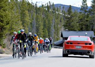 Competitors in the open division at the 2016 Imperial Challenge bike up Barton Road during the first leg of the race. Athletes in every division rode from the Breckenridge Rec Center to the base of Peak 8, skinned to the summit of Peak 8, and then skied back to the base.