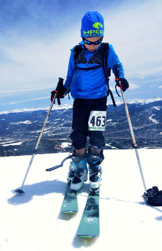 Young Charlie Reish clips into his skis after a short bootpack just below the summit of Peak 8 during the 2016 Imperial Challenge at Breckenridge on April 22. At 12 years old, Reish was one of the youngest competitors and the youngest by far in the men's open run division, which replaces the 6.2-mile bike with a run.