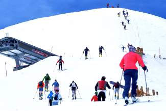A crowd of skiers and snowshoers pushes past Imperial Chair before the final bootpack of the 2016 Imperial Challenge at Breckenridge on April 22.