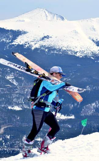 A skier hoofs it up Imperial Ridge with skis on her back during the 2016 Imperial Challenge at Breckenridge on April 22.