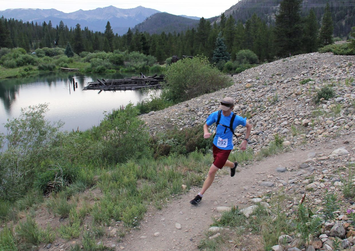 A runner in the Summit Trail Running Series weaves along a trail in Breckenridge. The series, which takes place on local trails at or above 9,000 feet, can test athletes who aren't already acclimated to the extreme altitude. But, when runners from altitude head to races at sea level their strength and speed can suffer.