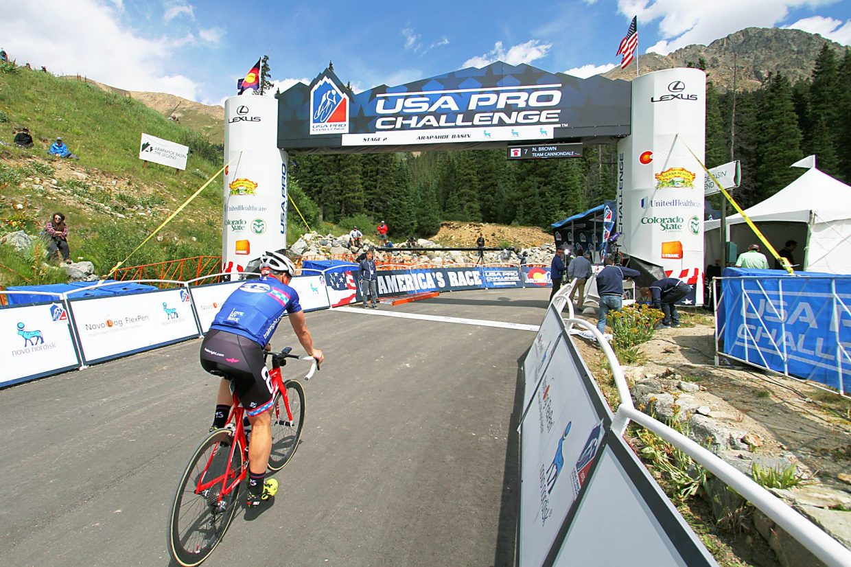 Hundreds of spectators begin to collect around the finish line at Arapahoe Basin to watch the Stage 2 sprint for the 2015 USA Pro Challenge. After the stage, riders talked about the 3,000-meter (9,000 feet) threshold, when the body is constantly in an anaerobic state because it can't keep up with the demands of cycling at max output.