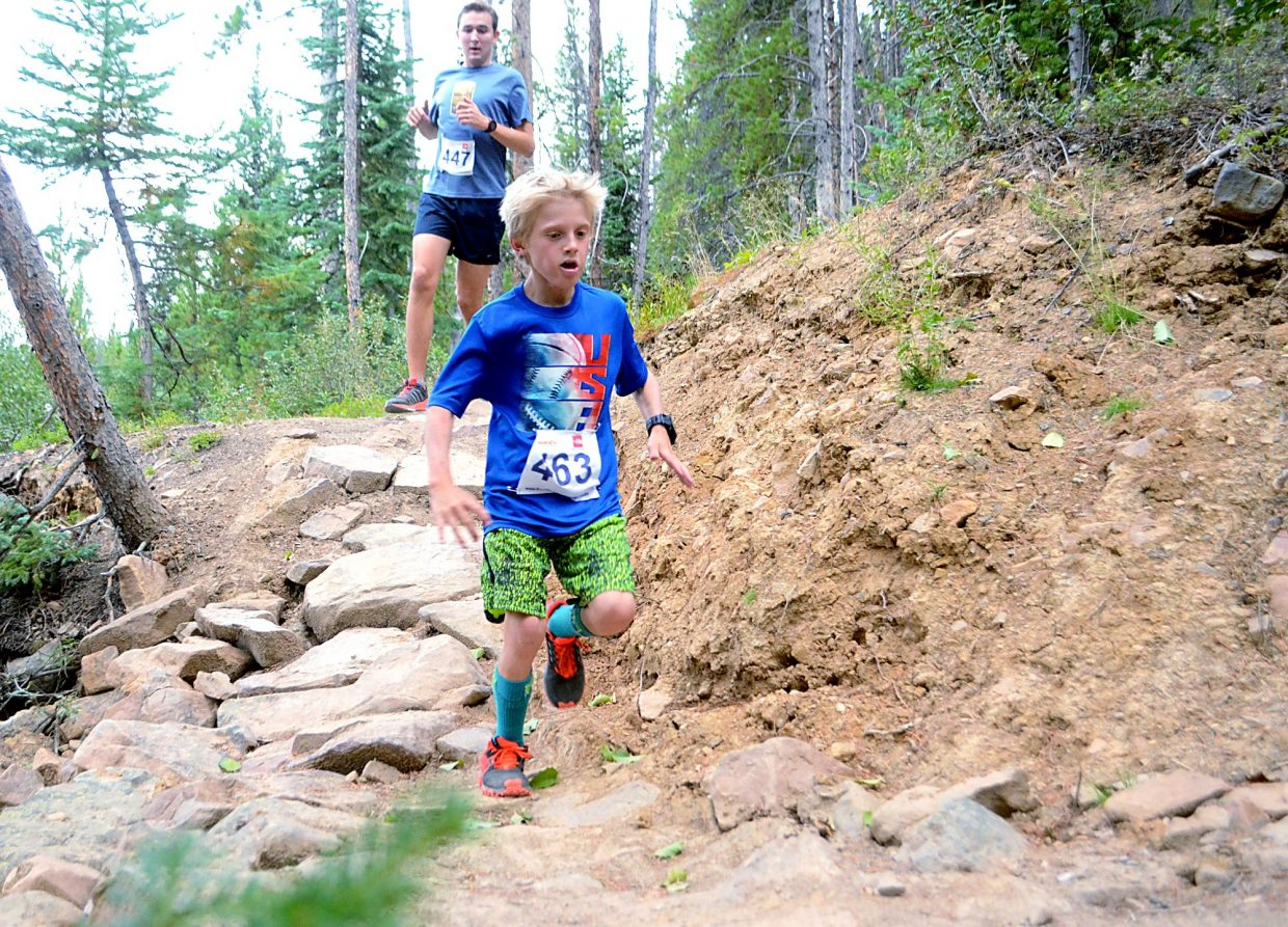 Little Nico Konency out-hustles a runner more than twice his age on the tricky Toms Baby trail in Breckenridge for the final race of the Summit Trail Running Series on Aug. 26.