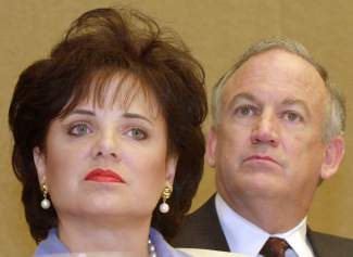 FILE - In this May 24, 2000 file photo, Patsy Ramsey and her husband, John, parents of JonBenet Ramsey, look on during a nws conference in Atlanta regarding their lie-detector examinations for the murder of their daughter. A Colorado judge on Wednesday, Oct. 23, 2013 ordered the release of the 1999 grand jury indictment in the killing of 6-year-old JonBenet Ramsey, possibly shedding light on why prosecutors decided against charging her parents in her death. Patsy Ramsey died in 2006. (AP Photo/Ric Feld, File)