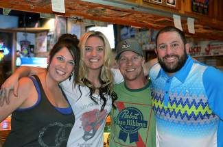 Jonny Greco, right, owner of Jonny-G's in Frisco, poses with his bar staff on closing night of the nightclub, Wednesday, April 30. Greco will open his new restaurant, Greco's, in mid-June.