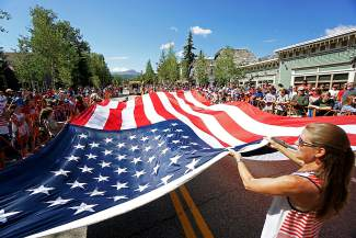 The American flag is carried down Main Street in Breckenridge during the 2016 4th of July Parade.
