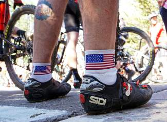 A man sporting American flag socks awaits the start of the Firecracker 50 Mountain Bike Race in Breckenridge Monday, July 4, 2016.