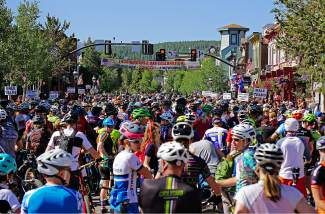 Racers line up on Main Street in Breckenridge for the start of the Firecracker 50 Mountain Bike Race Monday, July 4, 2016.