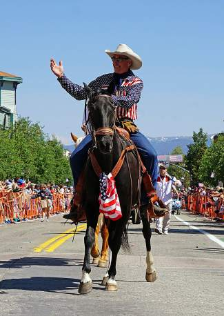 A man on horseback waves at the crowd at the 4th of July Parade on Main Street in Breckenridge Monday, July 4, 2016.