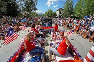 A float makes its way down Breckenridge Main Street on the 4th of July.