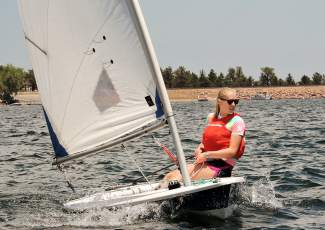 A sailor with the Dillon Junior Sailing program deftly steers her craft to the mark at a regatta on Carter Lake earlier this summer. The local program hosts the anual Rocky Mountain Junior Olympics regatta this weekend on Lake Dillon.