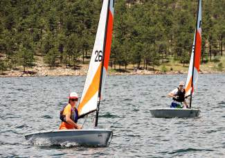 A young sailor with the Dillon Junior Sailing program passes another boat during an RS Tera race on Carter Lake earlier this summer. This weekend, more than 100 local and visiting youth sailors take to the waters of Lake Dillon for the 2016 Rocky Mountain Junior Olympics regatta.