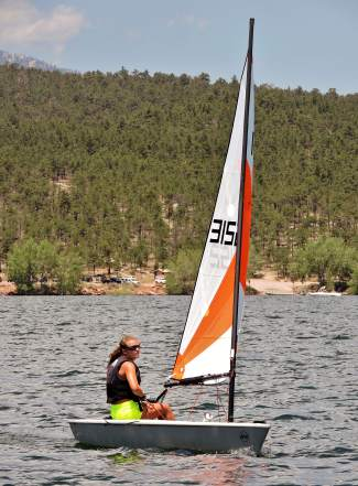 A young sailor with the Dillon Junior Sailing program commands an RS Tera boat at a junior regatta earlier this summer at Carter Lake on the Front Range. This weekend, the local program plays host to more than 100 youth sailors for the 2016 Rocky Mountain Junior Olympics regatta.