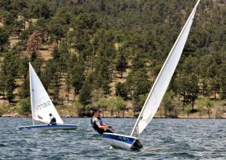 A young sailor shifts position to steer at a junior regatta on Carter Lake on the Front Range earlier this summer. More than 100 youth sailors come to Lake Dillon this weekend for the 2016 Rocky Mountain Junior Olympics regatta.