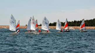 A collection of sailboats speeds to the mark at the 2015 Rocky Mountain Junior Olympics regatta at Cherry Creek Reservoir. The event returns to Lake Dillon this weekend for the first time since 2013, bringing more than 100 youth sailors from across the state, region and world.
