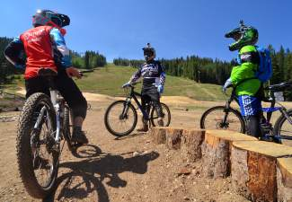 A Keystone Bike Academy instructor talks with two students at the Keystone skills park, a free collection of dirt jumps and other obstacles found at the base of the River Run gondola. The bike park is hosting Level II teacher training through the International Mountain Biking Association on July 21-24.