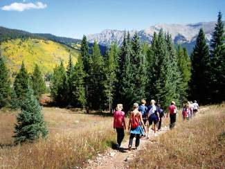 Nature hikes led by Sue Greene are an annual part of the Keystone CampExperience retreat for women. New adventures this year include an astronomy class and an introduction to target and skeet shooting.