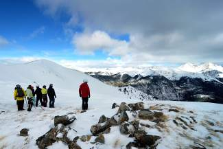 A group with Keystone Adventure Tours early this February takes in the view from the eastern rim of Independence Bowl, a portion of hike-to terrain on the far east side of the resort. In the far right-hand corner of the frame are Grays Peak (14,278 feet) and Torreys Peak (14,275 feet).