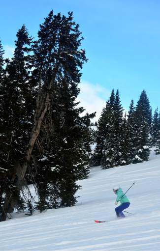 Skier Kimberly Beekman weaves through fresh snow in Bergman Bowl at Keystone nearly a week after the last snowstorm. Keystone Adventure Tours takes skiers and boarders on full-day trips to largely untouched terrain on the resort's eastern side.