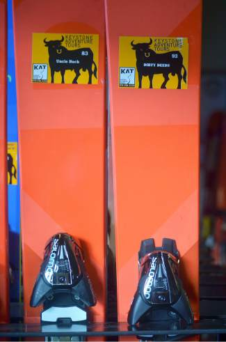 Demo skis in the Keystone Cat Tours office, labeled like the rest with names of Professional Bull Riders tour bulls. Why? It's easier than writing new nametags for each and every tour.