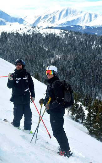 Keystone Adventure Tour guides James Regan (left) and Josh Miller (right) wait for a group to drop into Erikson Bowl during a tour in early February. All KAT guides spend 40-plus days every season skiing and exploring the backcountry bowls on the resort's east side.