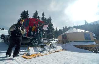 Skiers and snowboarders unload the Keystone Adventure Tours cat outside of the lunch yurt at the base of Independence Bowl in early February. Tours include a catered lunch between guided runs in one of three backcountry bowls: Independence, Bergman and Erikson.