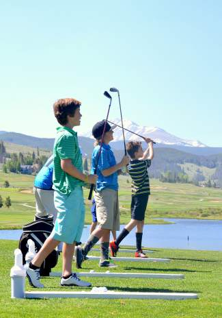 A group of three golfers with the PGA Junior League program practice chipping on the driving range at The Ranch Course in Keystone this June. Participants in the program rotate between putting, chipping and driving drills to prepare for weekly tournaments against their teammates and other league programs.